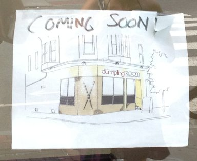 Artist's rendering of Dumpling House posted in the window