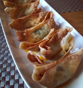 Watercress and soy cheese wontons