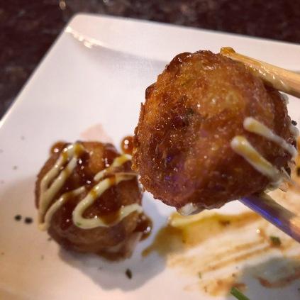 Flat bottomed takoyaki, suggestive of frozen takoyaki