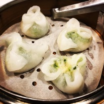 Steamed shrimp and pea vine dumplings