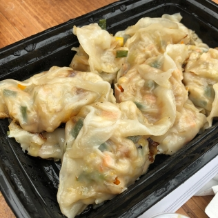 Exploded in the micro-wave pan-fried vegan dumplings from Bun Ramen.
