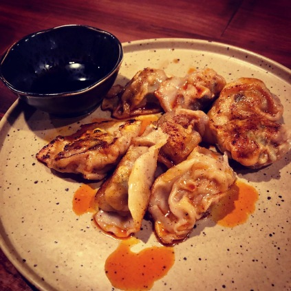Pan-Fried Pork Dumplings in Chili Oil