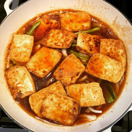 Tofu being braised